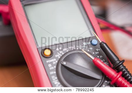 Closeup Of Digital Multimeter Unit With Two Probes Connected