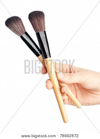 Makeup brush in hand