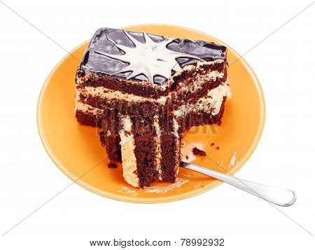 Chocolate cake on orange plate