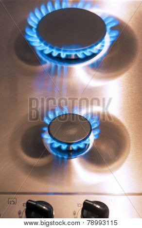 Two Gas Burners With Regulator Valves On Stove Surface