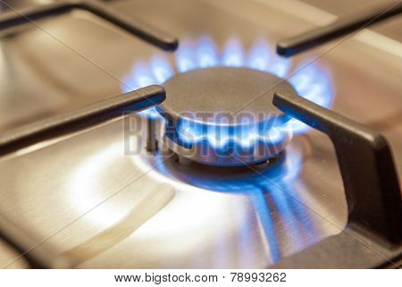 Closeup Shot Of Gas Burner On Stove Surface.
