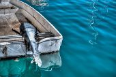 foto of outboard  - Outboard engine on an old boat - JPG