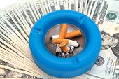 Cigarettes Ashtray And Money