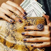 stock photo of cash  - pretty fingers of african american woman holding money close up with purse - JPG