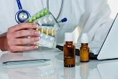 stock photo of placebo  - a doctor issues a prescription for medication - JPG