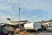 picture of fishnet  - old boat and many fishnet at sunset - JPG