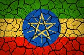 picture of ethiopia  - flag fo Ethiopia on a cracked ground - JPG