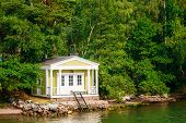 picture of sauna  - Yellow Finnish Wooden Sauna Log Cabin On Island In Summer - JPG
