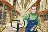 stock photo of dispatch  - worker in warehouse with bar code scanner - JPG