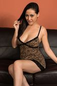 stock photo of camisole  - Beautiful multiracial woman in a leopard print camisole - JPG