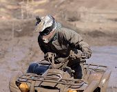 picture of overcoming obstacles  - Extreme driving ATV on overcoming mud obstacles - JPG
