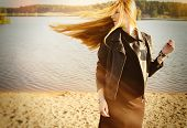 image of gothic hair  - beautiful woman long red hair on a wind near the lake develop - JPG