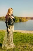 foto of gothic hair  - unusual gothic girl with long red hair reflects at the lake - JPG