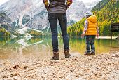 stock photo of south tyrol  - Closeup on mother and baby walking on lake braies in south tyrol italy - JPG