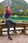 image of south tyrol  - Young woman on lake braies in south tyrol italy - JPG