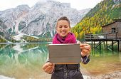 picture of south tyrol  - Happy young woman taking photo with tablet pc on lake braies in south tyrol italy - JPG