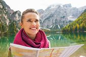picture of south tyrol  - Portrait of happy young woman with map on lake braies in south tyrol italy - JPG