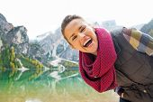 image of south tyrol  - Portrait of smiling young woman on lake braies in south tyrol italy - JPG