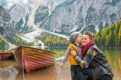 image of south tyrol  - Portrait of baby kissing mother on lake braies in south tyrol italy