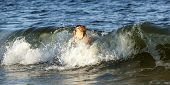 picture of dauphin  - boy enjoys swimming in the waves at Dauphin Island - JPG