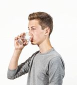picture of puberty  - portrait of attractive caucasian teenage boy drinking water - JPG