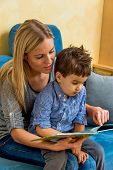 pic of dyslexia  - mother and son reading a book - JPG