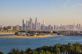 stock photo of dubai  - view of the group of skyscrapers of Dubai Marina with the Palm in Dubai - JPG