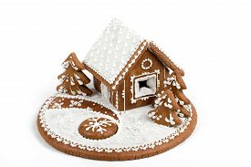 stock photo of gingerbread house  - Holiday Gingerbread house isolated on white christmas cookie - JPG