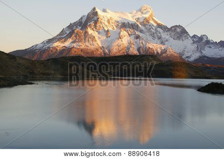 The Majestic Cuernos del Paine reflection during sunrise in Lake Pehoe in Torres del Paine