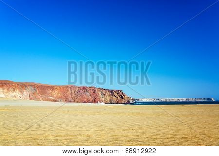 Desert And Colorful Cliff