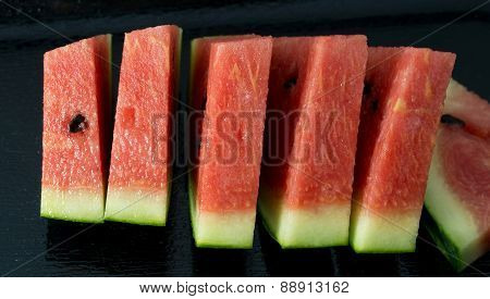 Close Up Of Watermelon On A Black Tray