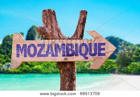 Mozambique wooden sign with beach background