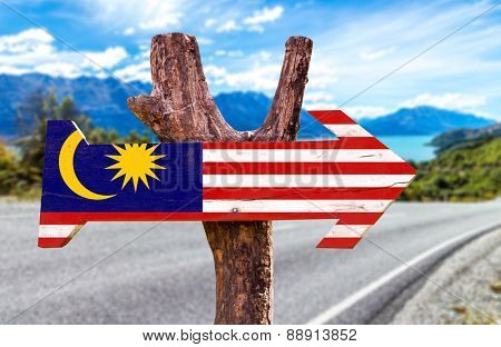 Malaysia Flag wooden sign with road background