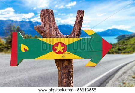 Grenada Flag wooden sign with road background
