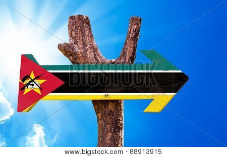 Mozambique Flag wooden sign with sky background