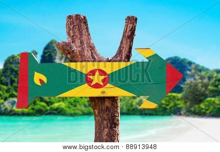 Grenada Flag wooden sign with beach background