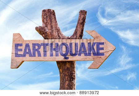 Earthquake wooden sign with sky background