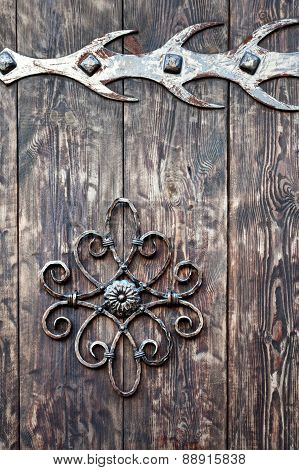 Old Rusty Decorative Element And Wood Door. Background