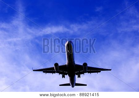 Silhouette Of Plane In Flight