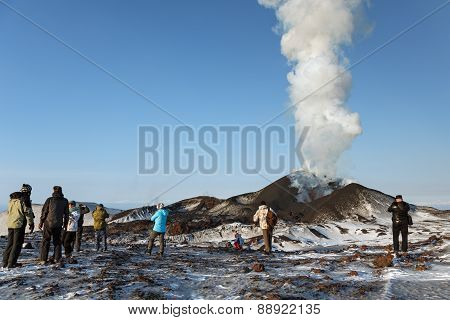 Tourists Watching The Eruption Of A Tolbachik Volcano, Ejecting Lava, Ash, Steam And Gas. Kamchatka