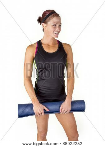 Smiling Fit woman holding her exercise mat sitting and enjoying her time at the gym