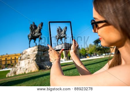 Tourist photographing Skanderbeg monument