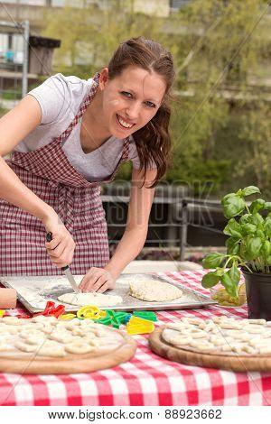 Woman Is Cutting Dough