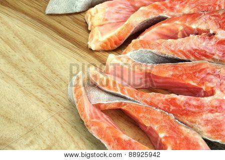 Fresh Raw Salmon Fish Steaks On Wood Cutting Board