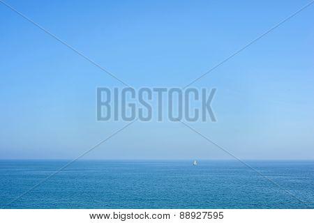 Seascape with blue sea, sky and yacht