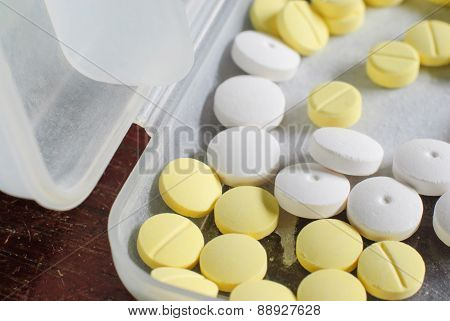 White And Yellow Round Medicine Tablets
