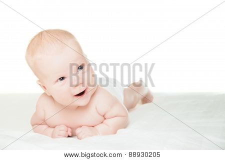 Little boy lying on stomach and smiling