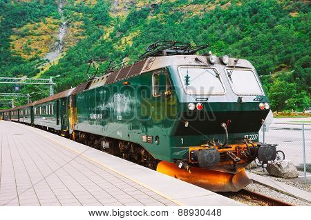 Flamsbahn In Flam, Norway. Green Train On Railway