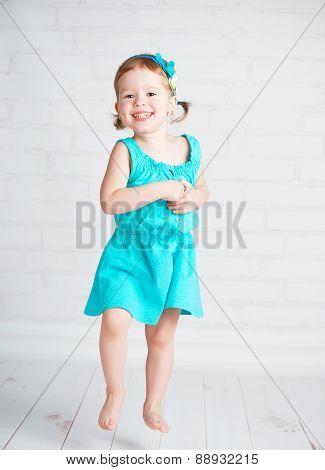 Happy Child Little Girl Jumping For Joy