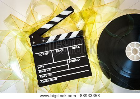 Clapper Board With 35Mm Film Yellow Frames And Movie Reel
